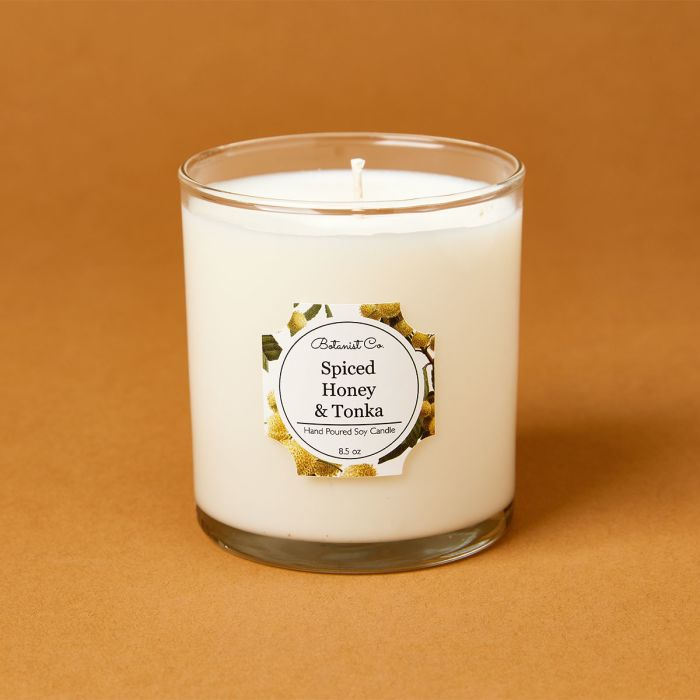 candle science spiced honey and tonka candle scent featuring avery candle label