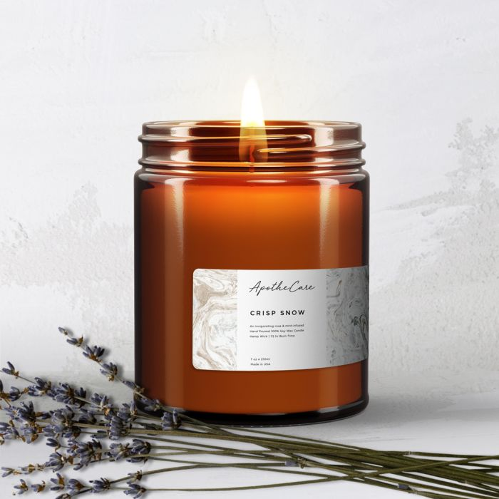 Use a narrow label placed horizontally on the bottom edge your container to brand your candle