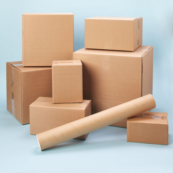 Stack of eight shipping boxes and tubes showing how to pack and ship for less