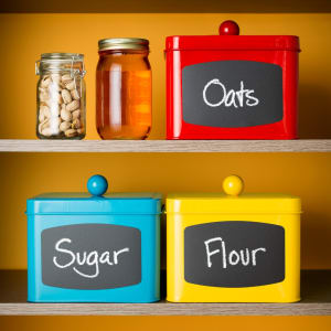 Sugar, flour and oats, on deck! Call out items with chalkboard labels, and you can erase and rewrite when you change the contents inside the bins.