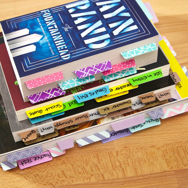 Stack of books with note tabs