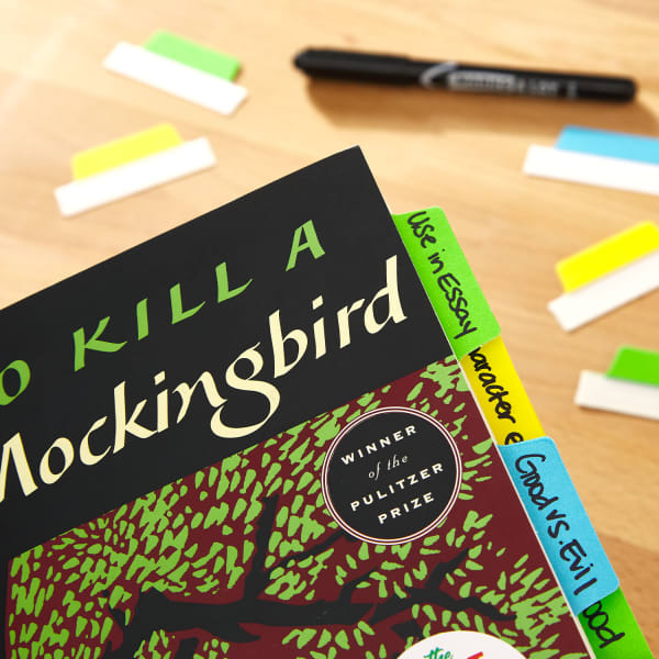 To Kill a Mockingbird with brightly colored notes