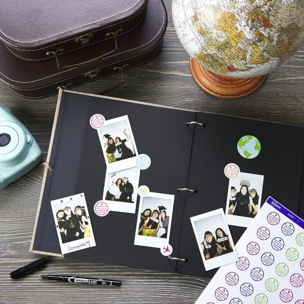 graduation party photobook gift with supplies and travel decorations