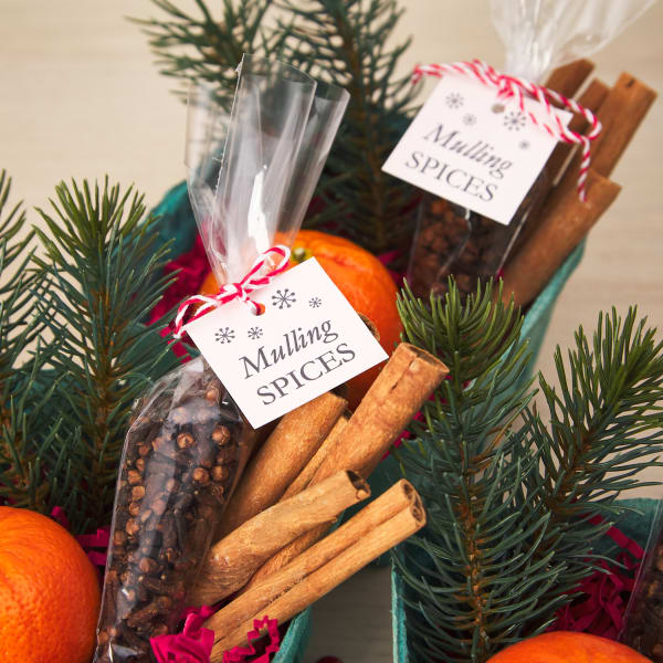 cellophane baggies filled with assorted spices tied closed with festive mulling spices square tags