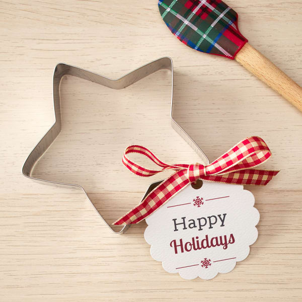 star-shaped cookie cutter with festive scallop tag tied by red ribbon