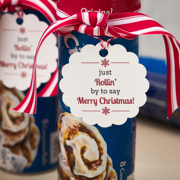 festive scallop tag with rolling by to say Merry Christmas message tied onto cinnamon roll container