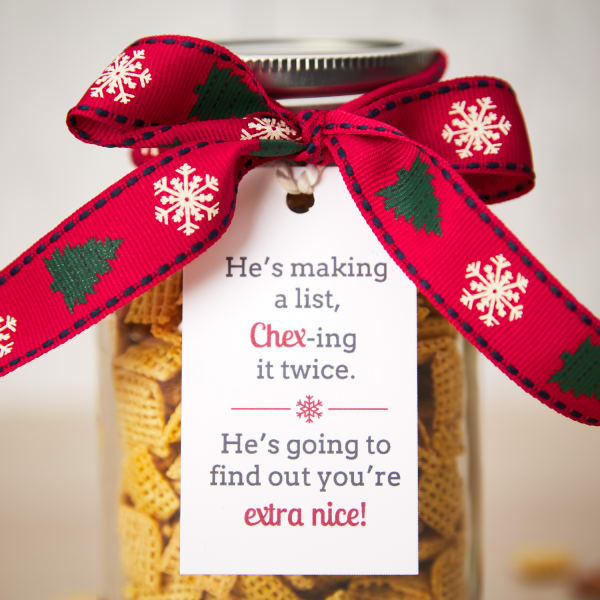 jar of Chex Mix with festive ribbon and holiday tag attached