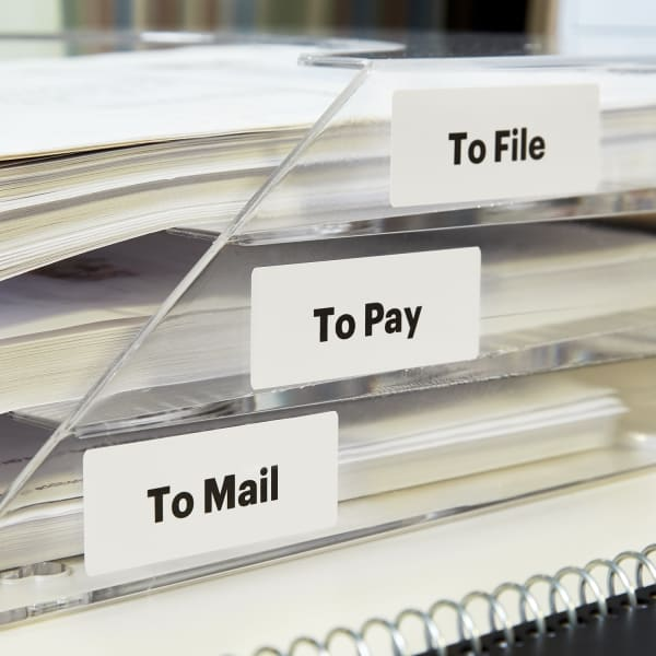 clear plastic tiered paper tray labeled for office organization