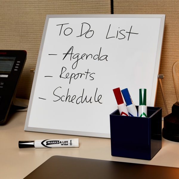 simple work desk organization idea with white board and dry erase markers neatly arranged on a cubicle desk