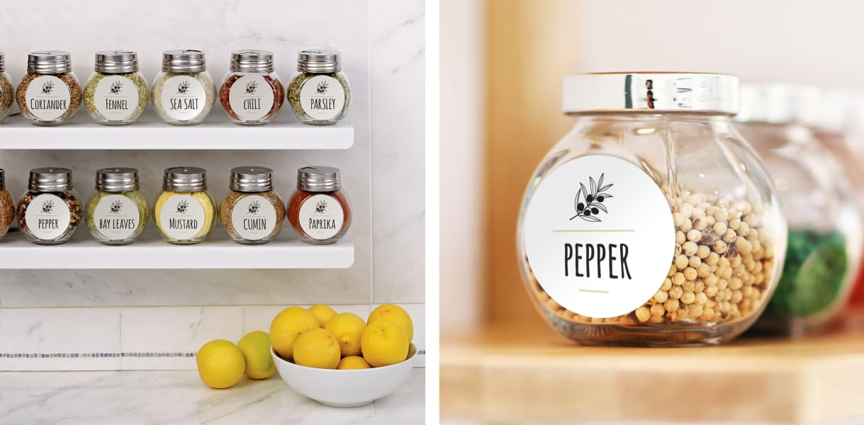 glass jars for pantry organization labeled with clear printable labels shown on a white marble counter with gold scissors