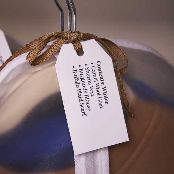 clothing item on hanger labeled with printable tag