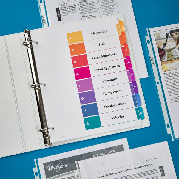 durable white binder with Ready Index dividers and sheet protectors on table