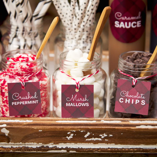 rustic chic diy hot chocolate bar signs with candy can stands dressed up with holiday greenery and festive red and white accents