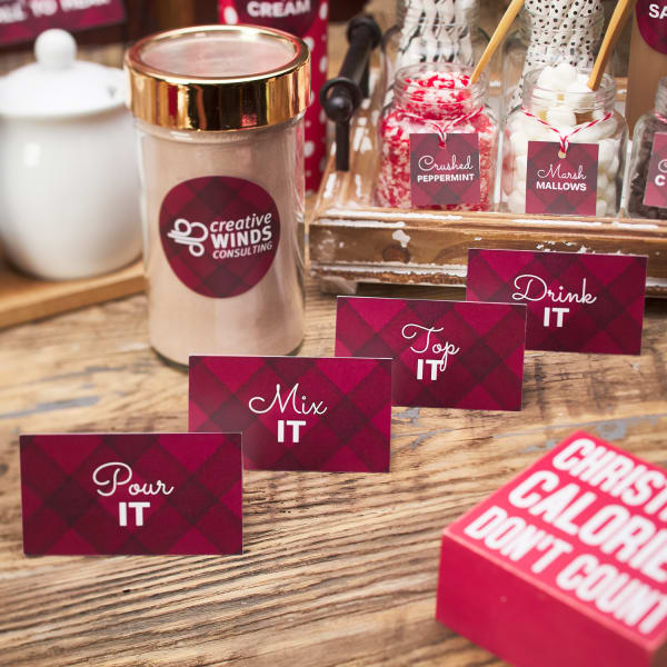 red plaid cute hot chocolate bar tent cards set up with holiday treats on a rustic chic wood table