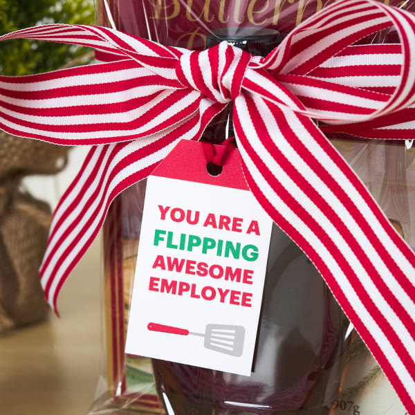 pancake mix kit tied with large red and white striped bow and festive gift tag