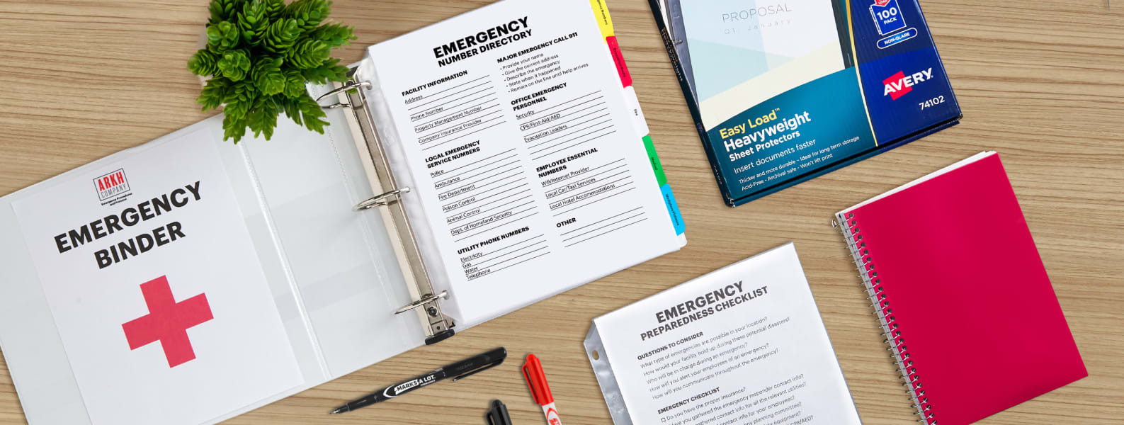supplies and what to put in an emergency binder laid out on a wooden table for emergency preparedness planning