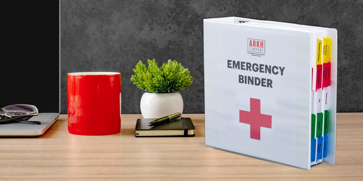 emergency binder printable cover sheet made with avery templates shown on a durable binder displayed on a clean modern wooden desk with gray background