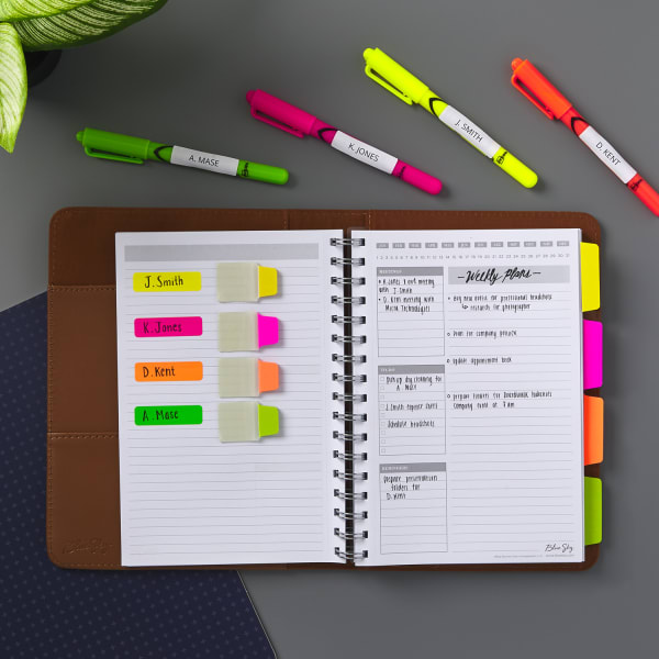 Neon highlighters with ultra tabs in a planner