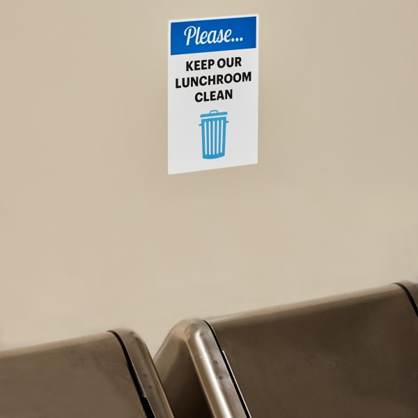 please keep our lunchroom clean blue and white removable office sign wall decal on painted drywall near trash cans