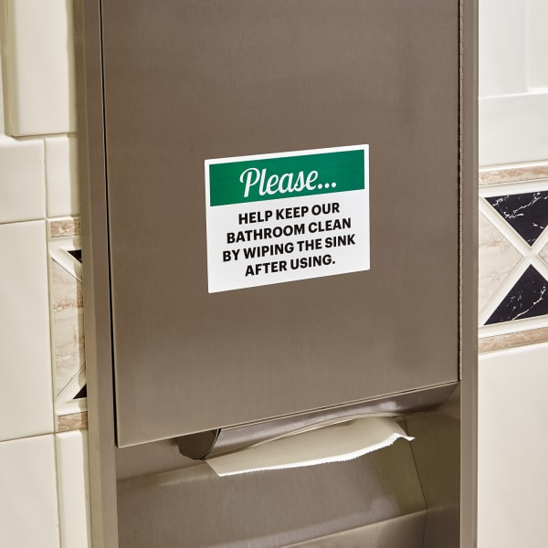 green and white bathroom etiquette office sign posted on metal paper towel dispenser