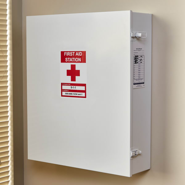 red and white first aid office sign on metal wall mounted workplace first aid kit