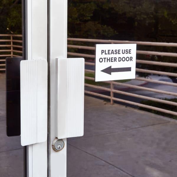 please use other door self adhesive door sign on glass door with arrow