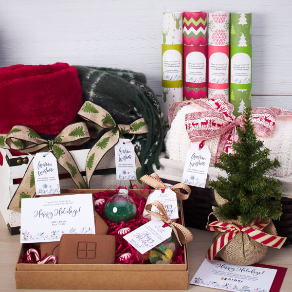 various holiday gifts with colorful wrapping, bows, and custom printed tags
