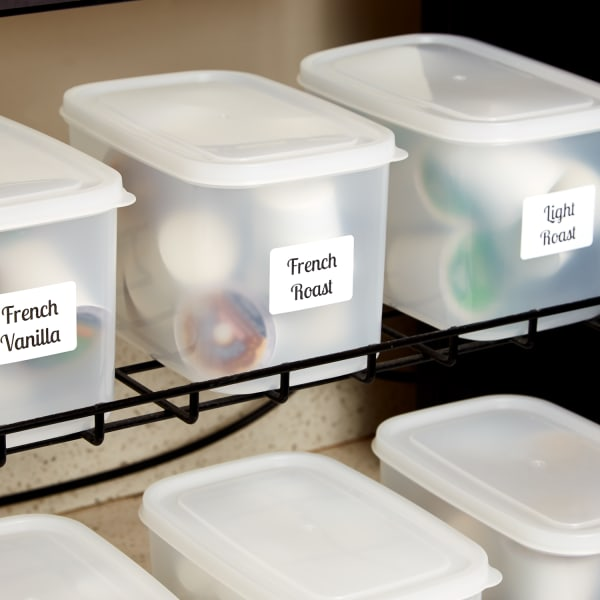 office coffee pod selections organized in semitransparent plastic containers with avery labels