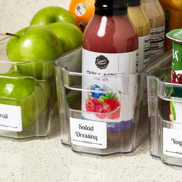 close up of avery labels use on plastic fridge bins filled with green apples salad dressing and yogurt