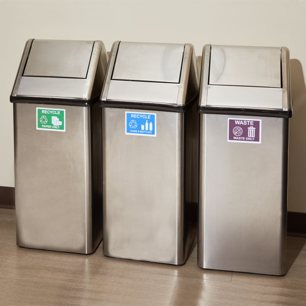 removable custom labels for stainless steel on three office trash cans for recycling