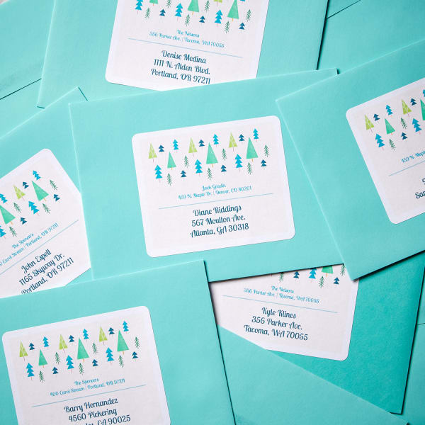 pile of light blue envelopes with large Avery 94267 labels