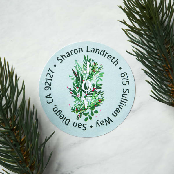 pale blue round label with mistletoe design on table