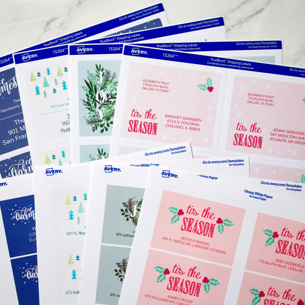 various sheets of Avery labels with an array of pink and blue Christmas-themed design templates from Avery Design and Print Online
