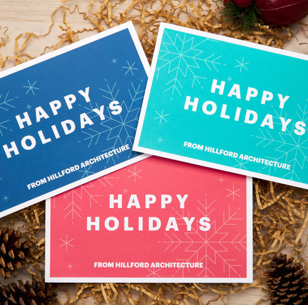 navy red and teal colorful modern holiday cards decoratively arranged with packing fill pine cones and apples for holiday mailing