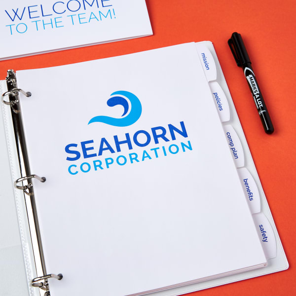 new hire branded onboarding welcome binder from Seahorn Corporation on bright orange table